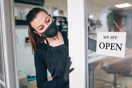 businesswoman opening shop