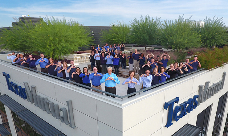 Texas Mutual staff on TXM rooftop garden